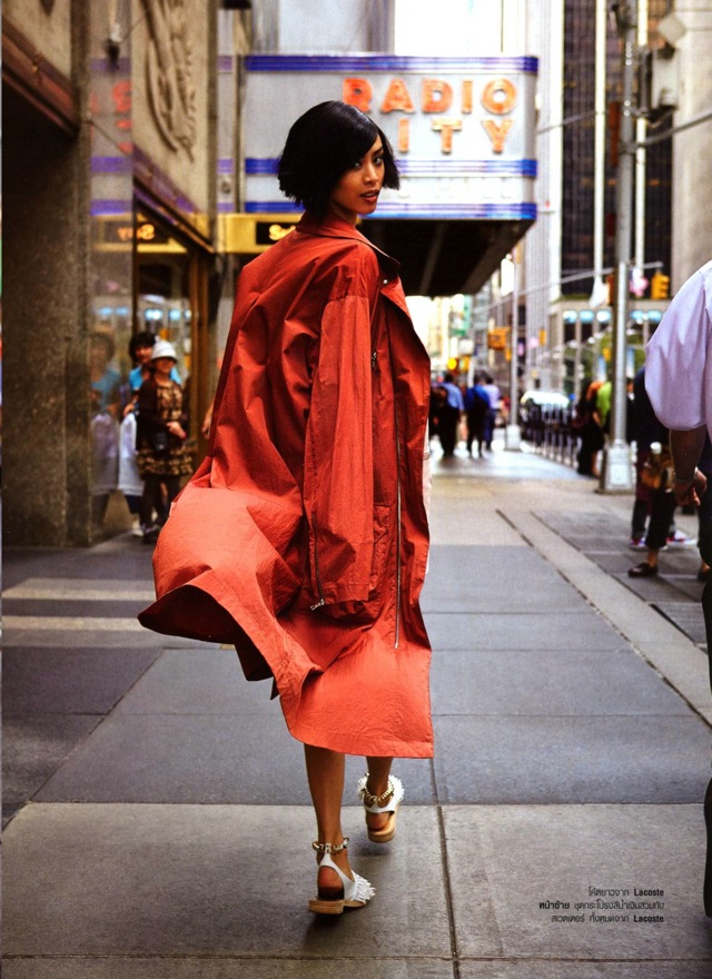 NYC orange coat with Si Tanwiboon photographed by Mitchell Nguyen Mccormack Harper's Bazaar Thailand Jan 2014- saved by Chic n Cheap Living