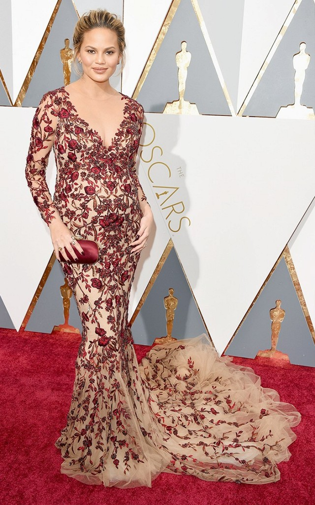 Oscars 2016 Best Dressed Chrissy Teigen in red and nude loral Marchesa gown