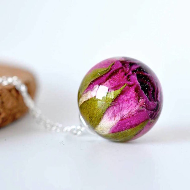 resity-rose in ball necklace