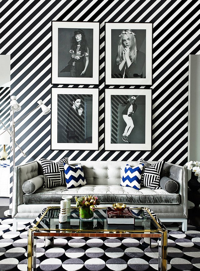 Black and white decor striped wall and circle rug by Greg Natale
