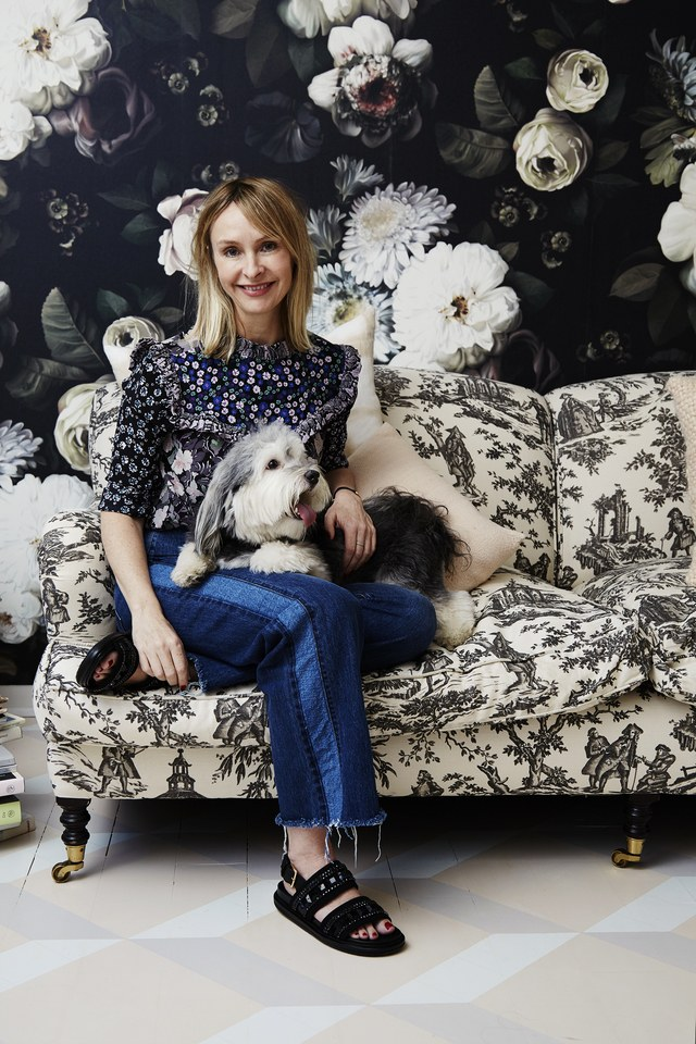Rebecca Taylor's Chic New York Office  Rebecca Taylor in front of Elie Cashman wallpaper