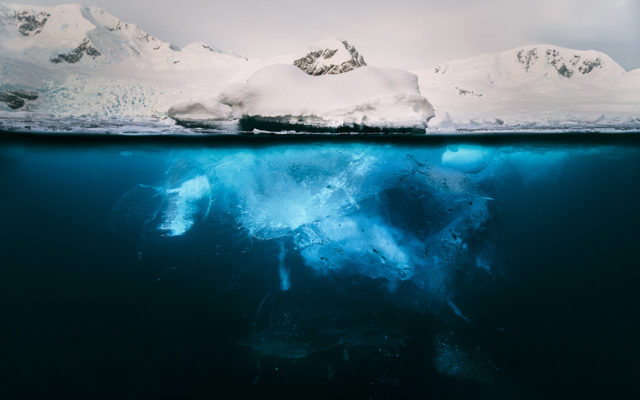 Trip to Antarctica by Josselin Corneau mountain iceberg below water