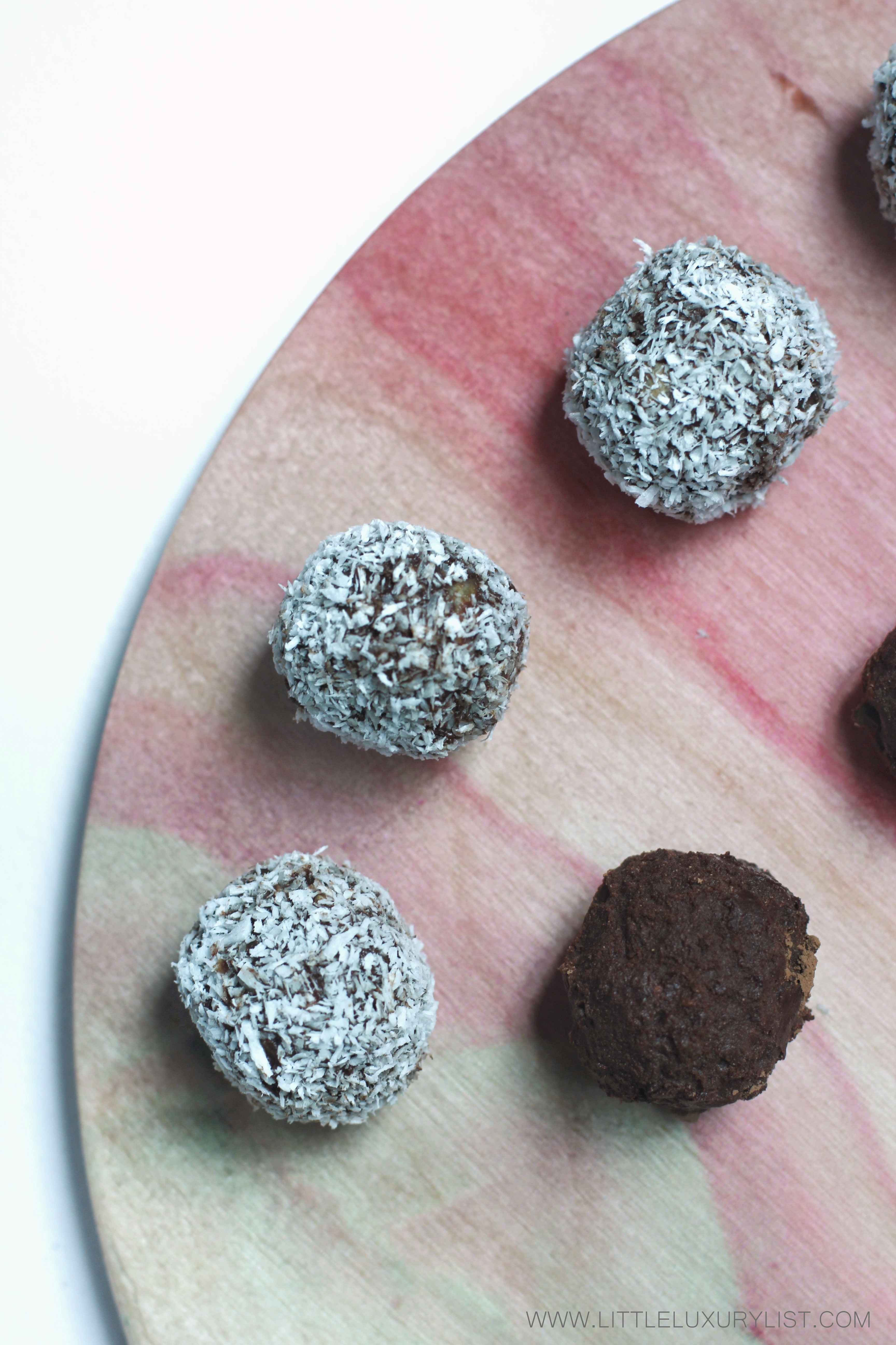 Healthy Chocolate Date Truffles top view pink board