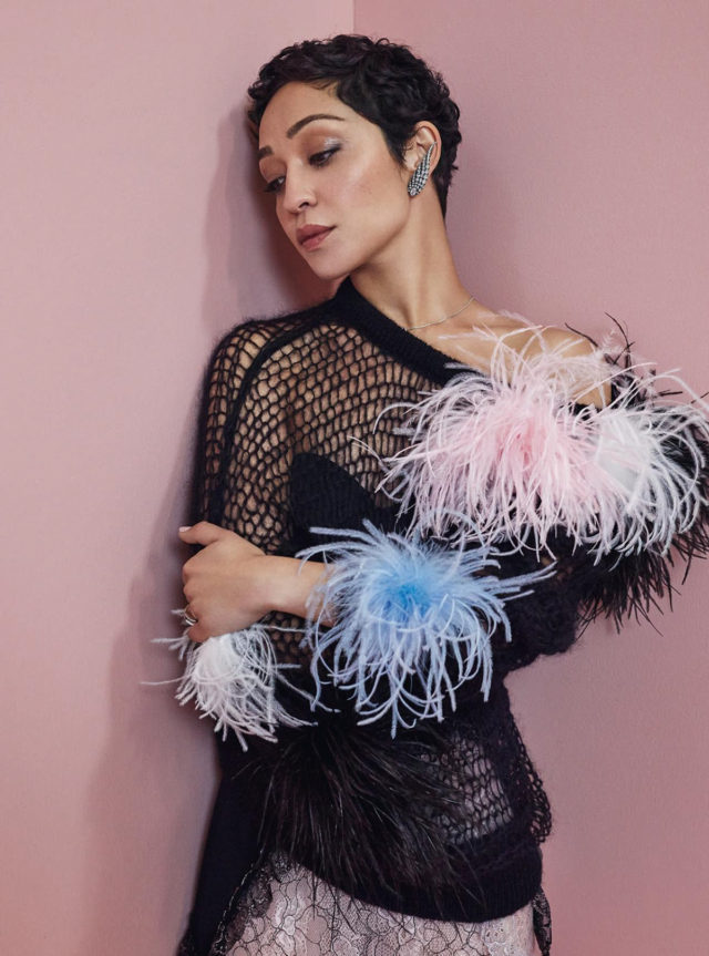 Ruth Negga for Harper's Bazaar December 2017 black sweather with ostrich feathers