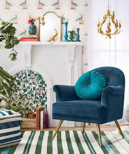 4b197c4ec Jewel toned velvet and brass chairs are sold alongside rustic chic rattan  side tables. I adore the accessories in this collection ...